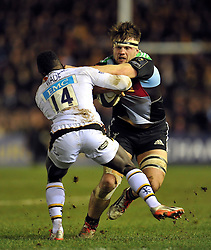 Charlie Matthews of Harlequins looks to fend Christian Wade of Wasps - Photo mandatory by-line: Patrick Khachfe/JMP - Mobile: 07966 386802 17/01/2015 - SPORT - RUGBY UNION - London - The Twickenham Stoop - Harlequins v Wasps - European Rugby Champions Cup