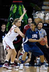 March 29, 2010; Sacramento, CA, USA; Xavier Musketeers forward April Phillips (42) is guarded by Stanford Cardinal forward Joslyn Tinkle (44) during the first half in the finals of the Sacramental regional in the 2010 NCAA womens basketball tournament at ARCO Arena.  Stanford defeated Xavier 55-53.