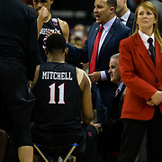 09 March 2018: San Diego State men's basketball takes on Nevada in the quarterfinal round of the Mountain West Conference Tournament. Associate head coach Justin Hutson and head coach Brian Dutcher talk with the team during a media timeout in the first half. TThe Aztecs cruise past the Wolfpack 90-73 to move on to the Championship game tomorrow afternoon at 3pm.<br /> More game action at www.sdsuaztecphotos.com