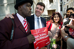 ©  London News Pictures. 19/07/2015. London, UK. ANDY BURNHAM poses for a photograph with supporters as he arrives at the event.  Labour leadership candidates Jeremy Corbyn, Yvette Cooper, Liz Kendall and Andy Burnham attend a hustings at the Camden Centre in London. The new leader is due to be announced in September 2015.  Photo credit: Ben Cawthra/LNP