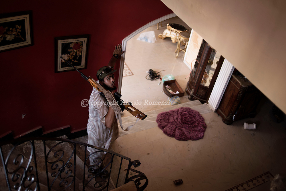 Libya: A Libya's Government of National Accord's (GNA) fighter is seen inside a building on the frontline with ISIS in Sirte. Alessio Romenzi