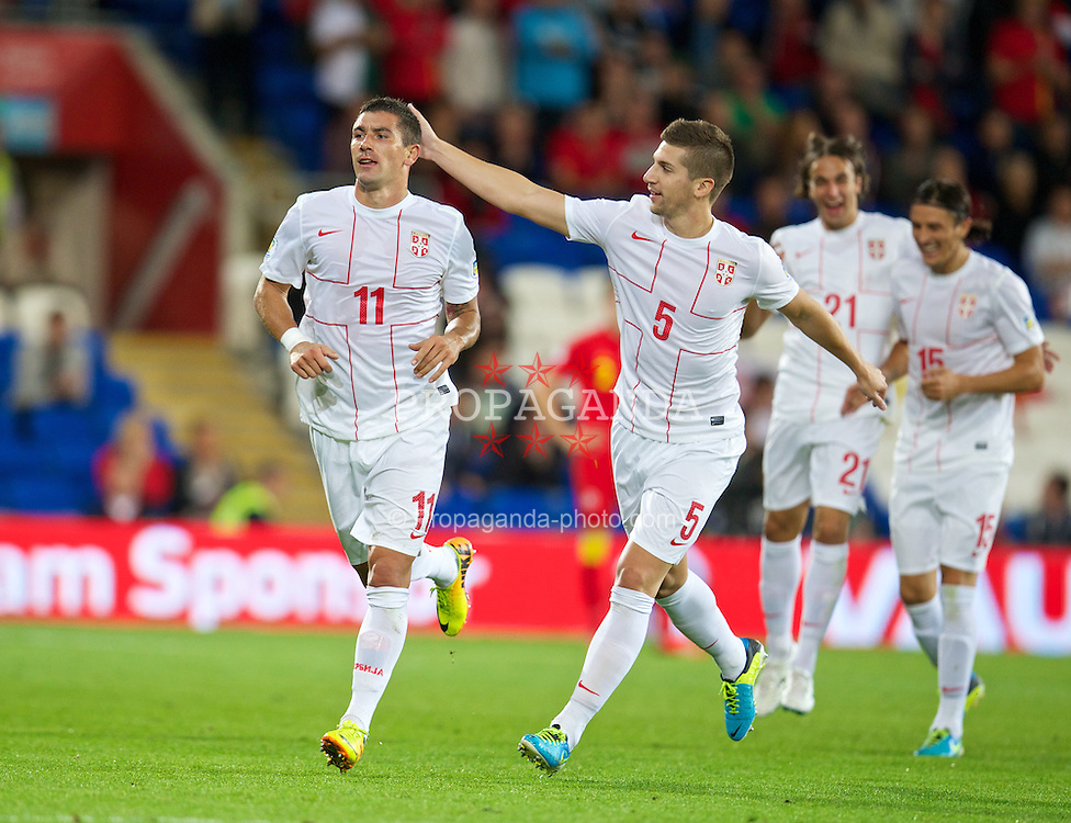 CARDIFF, WALES - Tuesday, September 10, 2013: Serbia's Aleksandar Kolarov celebrates scoring the second goal against Wales during the 2014 FIFA World Cup Brazil Qualifying Group A match at the Cardiff CIty Stadium. (Pic by David Rawcliffe/Propaganda)