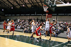 10 January 2009: Katherine Burshiem hacks Stacey Arlis from the back as Arlis shoots.The Illinois Wesleyan Titans, ranked #1 in the latest USA Today/ESPN poll, take down the Lady Reds of Carthage and remain undefeated,  2-0 in the CCIW and over all to 12-0. This is the first time in the history of the Lady Titans Basketball they have been ranked #1 The Titans and Lady Reds played in the Shirk Center on the Illinois Wesleyan Campus in Bloomington Illinois.