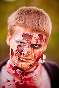 """Oct. 30, 2009 -- PHOENIX, AZ: A Zombie looks for a victim during the Zombie Walk in Phoenix Friday. About 200 people participated in the first """"Zombie Walk"""" in Phoenix, AZ, Friday night. The Zombies walked through downtown Phoenix """"attacking"""" willing victims and mixing with folks going to the theatre and downtown sports venues.  Photo by Jack Kurtz"""