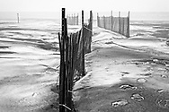 Erected for sand management more than snow, snowfences are very common on Port Stanley Beach during the winter months.