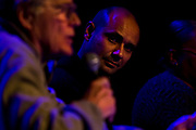 """Tariq Saqqaf, right, Madison's neighborhood resource coordinator, listens to a point made during the panel: """"How can Madison build more great neighborhoods?"""" at High Noon Saloon in Madison, Tuesday, November 7, 2017."""