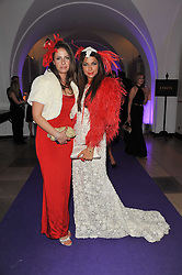 Left to right, NEGI RODA and JORDANA YECHIEL at The Surrealist Ball in aid of the NSPCC in association with Harpers Bazaar magazine held at the Banqueting House, Whitehall, London on 17th March 2011.