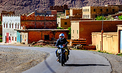 A motocyclist rides through the mountain village of Tamtetoucht, Morocco<br /> <br /> (c) Andrew Wilson | Edinburgh Elite media