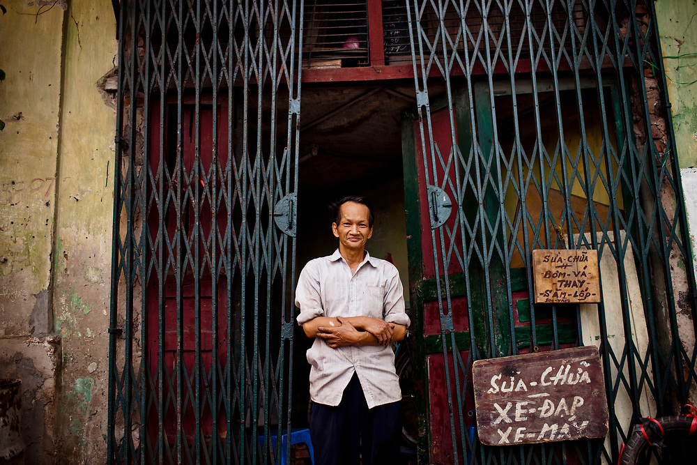 A portrait of an elderly man at his motorbike shop in the Old Quarter of Hanoi, Vietnam.
