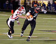 Sophomore Andrew McConnell (44) and senior Trent Koehler (7) early in the first quarter as the Wayne Warriors play the Beavercreek High School Beavers at the Frank Zink Field in Beavercreek, Friday, October 7, 2011.