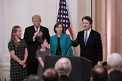 U.S. Supreme Court Justice Brett Kavanaugh smiles at his ceremonial swearing in as President Donald Trump, Kavanaugh's wife Ashley, youngest daughter Liza and oldest daughter Margaret look on in the East Room of the White House October 08, 2018 in Washington, DC.Photo by Olivier Douliery/ Abaca Press