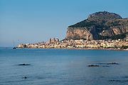 The hill around which is built the coastal town of Cefalu with Baroque style architecture in Northern Sicily, Italy