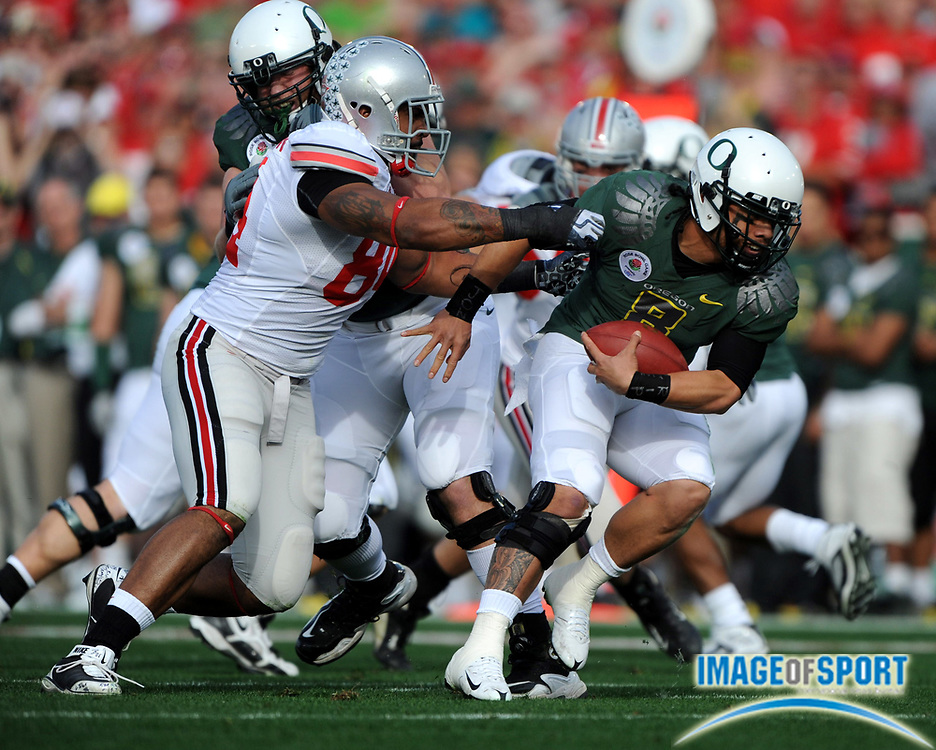 Jan 1, 2010; Pasadena, CA, USA; Oregon Ducks quarterback Jeremiah Masoli (8) is pressured by Ohio State Buckeyes defensive end Doug Worthington (84)in the first quarter of the 2010 Rose Bowl at the Rose Bowl.