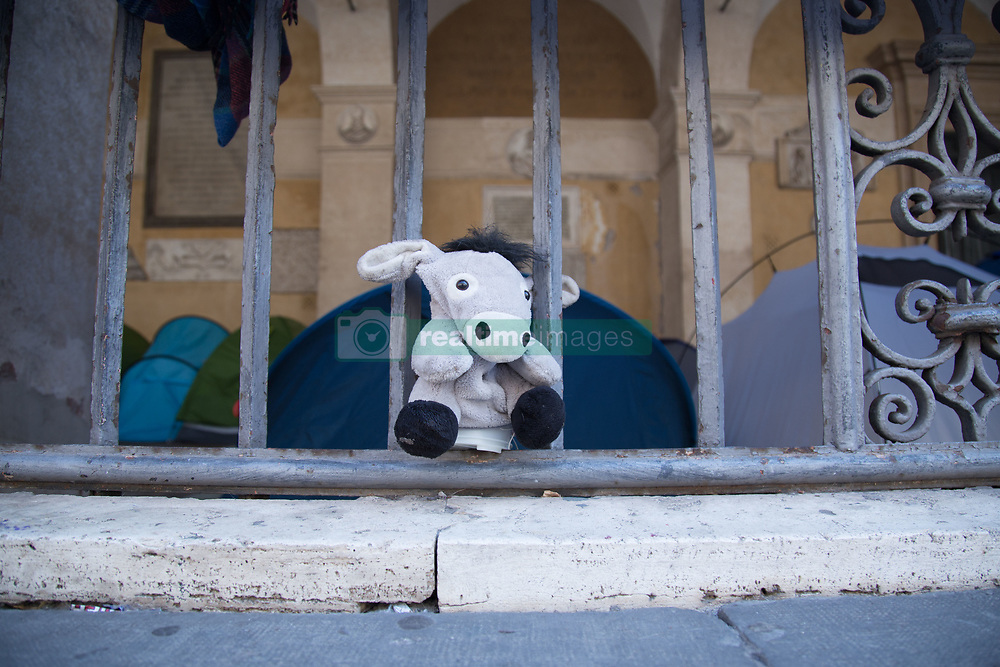 August 26, 2017 - Roma, RM, Italy - The 60 families of refugees who from two weeks occupy the basement of the SS Apostles have been waiting for the demonstration this afternoon at Piazza dell'Esquilino in Rome (Credit Image: © Matteo Nardone/Pacific Press via ZUMA Wire)
