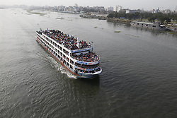 June 15, 2018 - Dhaka, Bangladesh - Dhaka, Bangladesh. Bangladeshi people rush to homes on overcrowded ferry along the Buriganga River to celebrate Eid-ul-Fitr festival with their families and friends, in Dhaka, Bangladesh on June 15, 2018. (Credit Image: © Rehman Asad/NurPhoto via ZUMA Press)