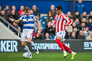 Jake Bidwell (Queens Park Rangers) & Tom Ince (Stoke) during the EFL Sky Bet Championship match between Queens Park Rangers and Stoke City at the Loftus Road Stadium, London, England on 9 March 2019.