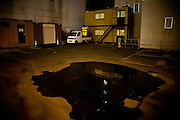 SAPPORO, JAPAN, 5 SEPTEMBER, A puddle of water in a middle of a parking have the shape of a head. September 2010