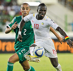 MALABO, Jan. 28, 2015  Sadio Mane of Senegal (R) competes during the group match of Africa Cup of Nations against Algeria at the Stadium of Malabo, Equatorial Guinea, Jan. 27, 2015. Algeria won 2-0.  (Xinhua/Li Jing) (Credit Image: © Xinhua via ZUMA Wire)