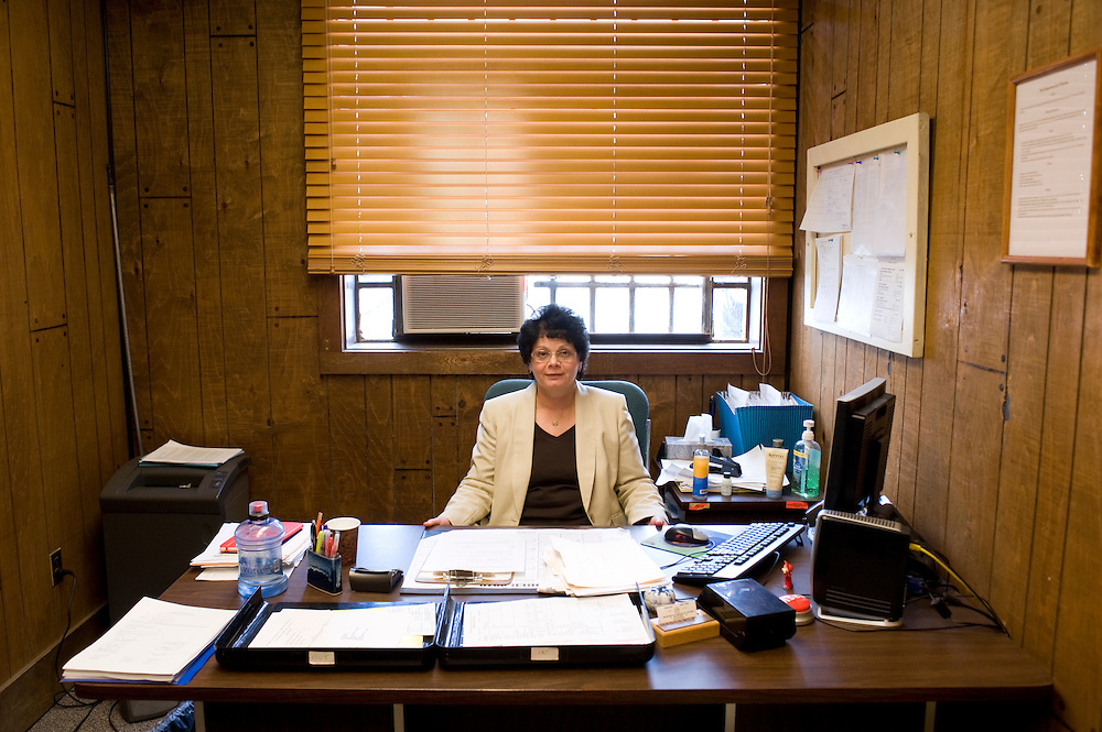 "Deputy Superintendent for Programs at Woodbourne Correctional Facility Jean King in her office at the facility...Story: The Bard Prison Initiative.Former inmate Carlos Rosario, 35-year-old husband and father of four, was released from Woodbourne Correctional Facility after serving more than 12 years for armed robbery. Rosado is one of the students participating in the Bard Prison Initiative, a privately-funded program that offers inmates at five New York State prisons the opportunity to work toward a college degree from Bard College. The program, which is the brainchild of alumnus Max Kenner, is competitive, accepting only 15 new students at each facility every other year. .Carlos Rosario received the Bachelor of Arts degree in social studies from the prestigious College Saturday, just a few days after his release. He had been working on it for the last six years. His senior thesis was titled ""The Diet of Punishment: Prison Food and Penal Practice in the Post-Rehabilitative Era,"".Rosado is credited with developing a garden in one of the few green spaces inside the otherwise cement-heavy prison. In the two years since the garden's foundation, it has provided some of the only access the prison's 800 inmates have to fresh vegetables and fruit...Rosario now works for a recycling company in Poughkeepsie, N.Y...Photo © Stefan Falke"