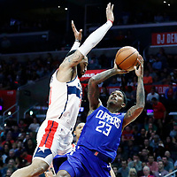 09 December 2017: LA Clippers guard Lou Williams (23) takes a jump shot over Washington Wizards forward Mike Scott (30) during the LA Clippers 113-112 victory over the Washington Wizards, at the Staples Center, Los Angeles, California, USA.