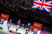 Podium Reem Acra FEI World Cup FInal 1. Charlotte Dujardin - Valegro, 2. Helen Langehanenberg - Damon Hill NRW, 3. Edward Gal - Glock's Undercover<br /> FEI World Cup Final 2014<br /> © DigiShots