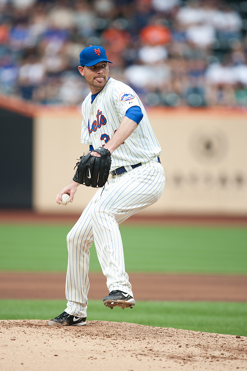 NEW YORK - JULY 10: Mike Pelfrey #34 of the New York Mets pitches against the Atlanta Braves at Citi Field on July 10, 2010 in the Queens borough of New York City. The Braves defeated the Mets 4 to 0. (Photo By: Rob Tringali) *** Local Caption *** Mike Pelfrey