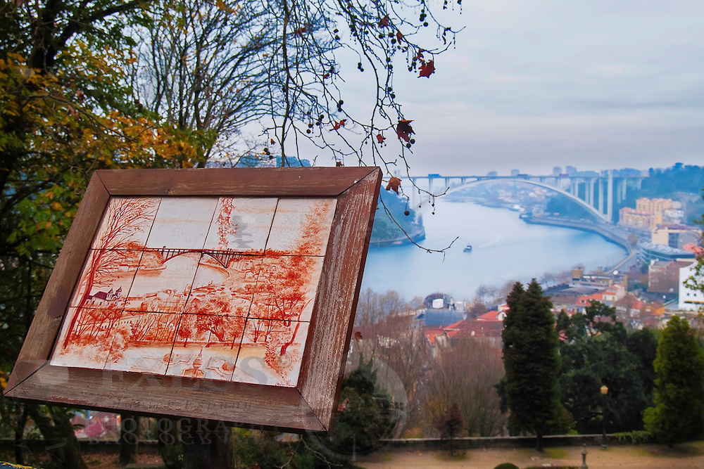 Oporto, December 2012. View of Arrabida bridge from Crystal Palace Gardens. Glazed tile representing the view. Arrabida bridge on concrete, Edgar Cardoso 1963, 615 meters over Douro river.