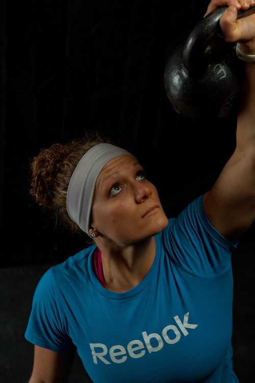 Quinn Megargel does a kettlebell turkish getup, Crossfit image, picture, photo, photography of health, elite, exercise, training, workouts, WODs, taken at Progressive Fitness CrossFit,Colorado Springs, Colorado, USA.