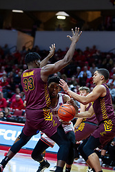 NORMAL, IL - January 19: Zach Copeland attempts to squeeze between Franklin Agunanne and Lucas Williamson during a college basketball game between the ISU Redbirds and the Loyola University Chicago Ramblers on January 19 2020 at Redbird Arena in Normal, IL. (Photo by Alan Look)