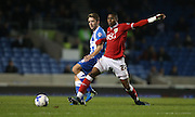 Bristol City striker Jonathan Kodija (22) closes down Brighton central midfielder, Dale Stephens (6) during the Sky Bet Championship match between Brighton and Hove Albion and Bristol City at the American Express Community Stadium, Brighton and Hove, England on 20 October 2015.