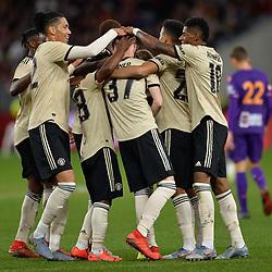 Man United celebrate after James Garner of Man United's goal