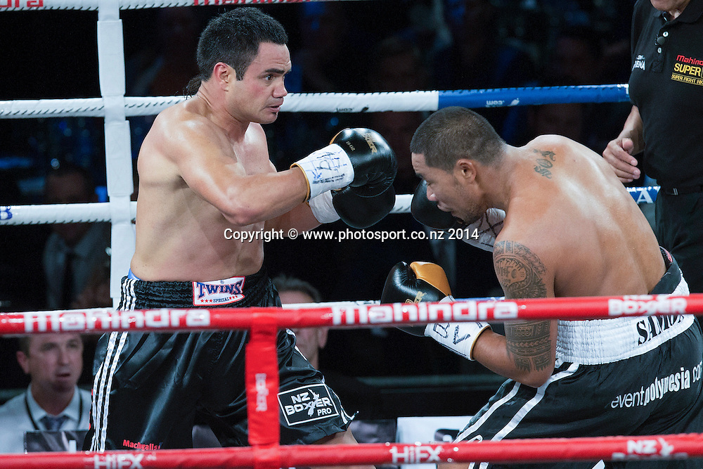 Lance `Buster` Bryant  (L) fights Vaitele SoI in the Mahindra Super 8 Fight Night, North Shore Events Centre, Auckland, New Zealand, Saturday, November 22, 2014. Photo: David Rowland/Photosport
