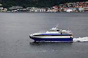 Fast small water taxi ferry boat service in city of Bergen, Norway