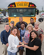 "Houston ISD transportation managers pose with a Telly Award the department received for the ""School Bus Shuffle"" video, April 1, 2014."