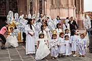 Young girls dressed as angels gather in front of the Parroquia de San Miguel Arcangel church at the start of the week long fiesta of the patron saint Saint Michael  September 21, 2017 in San Miguel de Allende, Mexico.