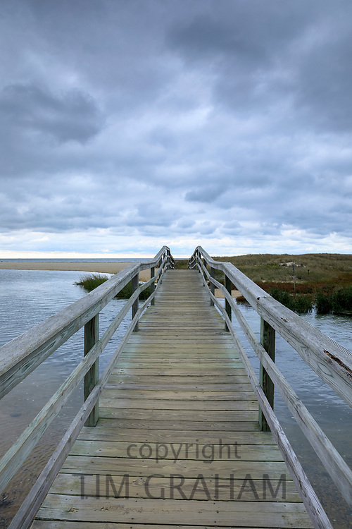 The way ahead - wooden footbridge walkway at Ridgevale Beach, Nantucket Sound, Cape Cod, New England, USA