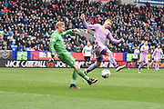 Bolton Wanderers Goalkeeper, Ben Amos clears in front of Reading On Loan Forward, Matej Vydra during the Sky Bet Championship match between Bolton Wanderers and Reading at the Macron Stadium, Bolton, England on 2 April 2016. Photo by Mark Pollitt.