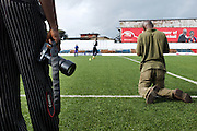 Toby kneels to photograph the goalkeepers of the Liberian Lonestars as photographer and editor Abbas Dulleh observes.