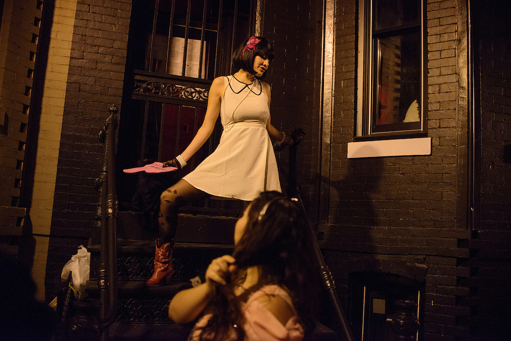 Photo by Matt Roth.Assignment ID: 10137081A..Alicia Rios climbs a rowhouse stoop during her friend's birthday pub crawl along H Street, N.E., the new, hip, D.C. area Sunday, January 13, 2013...H Street, N.E, in Washington D.C. was recently ranked sixth on Forbes magazine's list of the nation's best hipster neighborhoods.