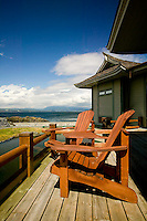 Two Adirondack chairs on the deck of the Aveda Concept Spa at April Point on Quadra Island await clients after their treatments.  Quadra Island, British Columbia, Canada