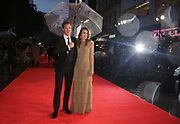 British actors Benedict Cumberbatch and Keira Knightley pose for photographers during the premiere of the film The Imitation Game, at the Odeon in Leicester Square, central London, which opens the London Film Festival, Wednesday, Oct. 8, 2014. (Photo by Joel Ryan/Invision/AP)