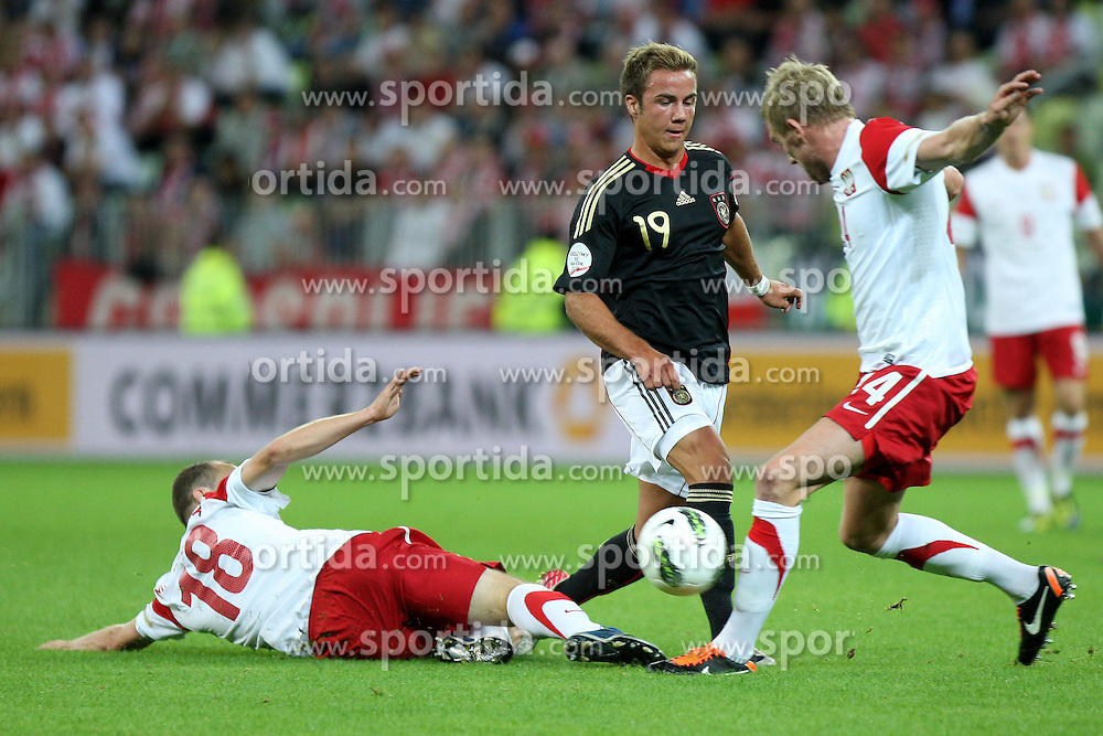 06.09.2011, PGE Arena, Danzig, POL, FSP, Polen vs Deutschland, im Bild ADRIAN MIERZEJEWSKI, DAMIEN PERQUIS (POL), MARIO GOETZE (GER)// during the international frindly football game between Poland and Germany at PGE Arena Gdansk Poland on 2011-09-06. EXPA Pictures © 2011, PhotoCredit: EXPA/ Newspix/ Tomasz Jastrzebowski +++++ ATTENTION - FOR AUSTRIA/(AUT), SLOVENIA/(SLO), SERBIA/(SRB), CROATIA/(CRO), SWISS/(SUI) and SWEDEN/(SWE) CLIENT ONLY +++++