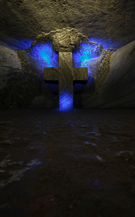 Illuminated Holy Cross carved out of salt  deep in the Salt Cathedral of Zipaquira, Colombia, South America