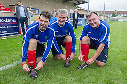 © Licensed to London News Pictures . 22/09/2013 . Lancing , UK . L-R Andy Burnham , Clive Efford and Ed Balls ' tying their rainbow laces , worn in support of an anti homophobia in football campaign . Labour Party vs journalists football match . Day 1 of the Labour Party 's annual conference in Brighton . Photo credit : Joel Goodman/LNP
