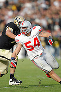 WEST LAFAYETTE, IN - NOVEMBER 12: John Simon #54 of the Ohio State Buckeyes rushes against the Purdue Boilermakers at Ross-Ade Stadium on November 12, 2011 in West Lafayette, Indiana. Purdue defeated Ohio State 26-23 in overtime. (Photo by Joe Robbins) *** Local Caption *** John Simon