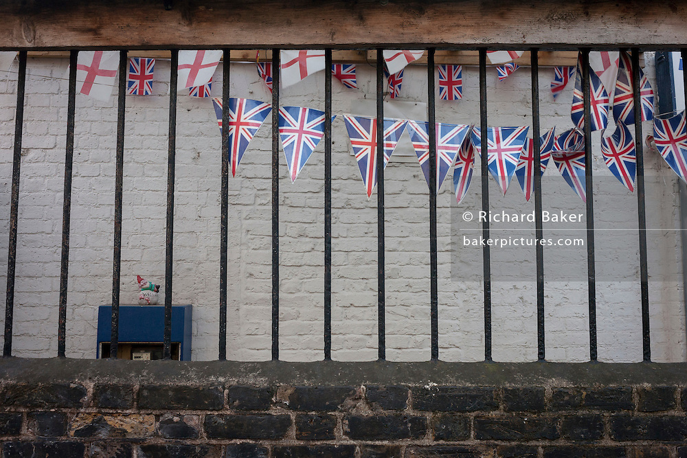 Union Jack pennants and a small gnome outside a south London social club for former service personnel, on 4th January, Camberwell, London borough of Southwark, England.