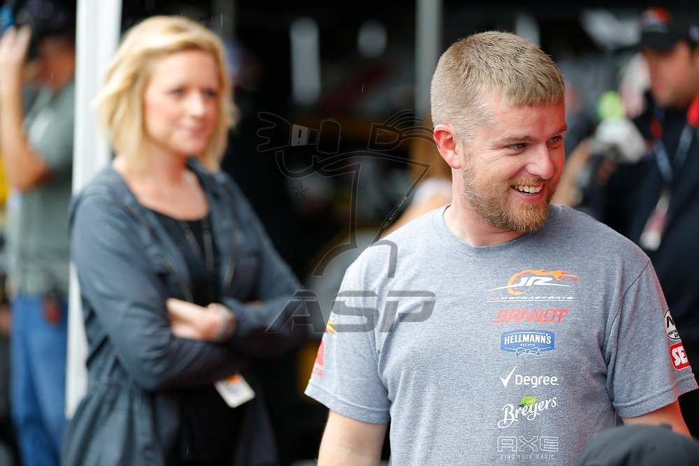 Justin Allgaier (7) hangs out in the garage during practice for the Zippo 200 at Watkins Glen International in Watkins Glen, New York.