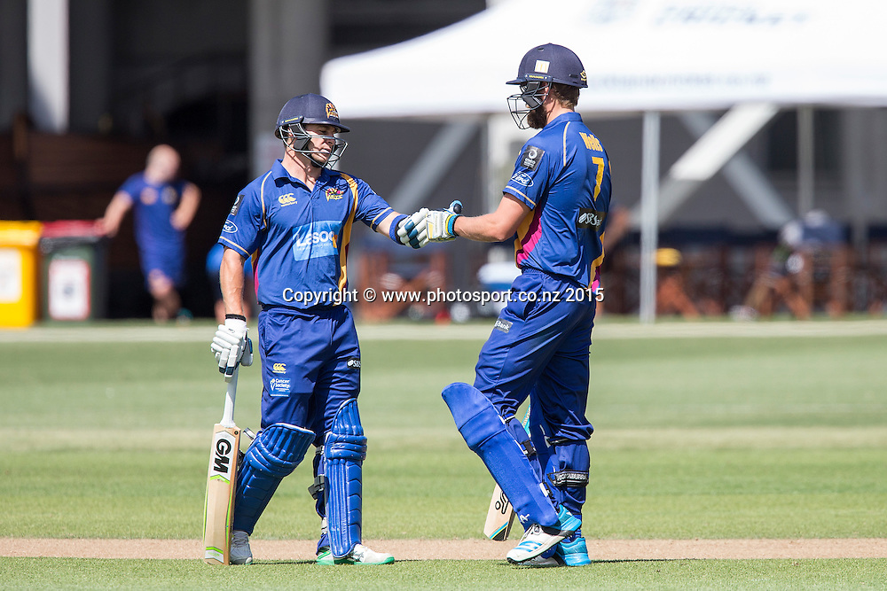 Volts` Nathan McCullum, left, and Sam Wells confer whilst batting in the Auckland Aces v Otago Volts, One Day Ford Trophy Cricket Match, Eden Park, Auckland, New Zealand, Friday, January 02, 2015. Photo: David Rowland/Photosport