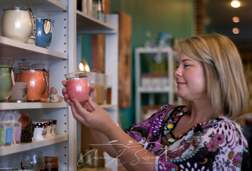Kellie Bishop inspects a candle at Hollyhocks Aug. 16, 2010 in Columbus, Miss. The store sells a variety of gifts for every occasion. (Photo by Carmen K. Sisson/Cloudybright)