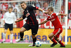 Bayern Munich v FC Koln. Lukas Podolski pulls Philipp Lahm by the nose.